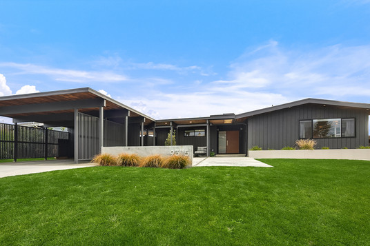 midcentury modern house with carport