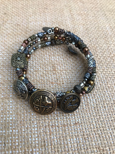 Mixed metal memory wire bracelet with 3 vintage buttons
