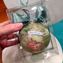 globe ornament with city banner