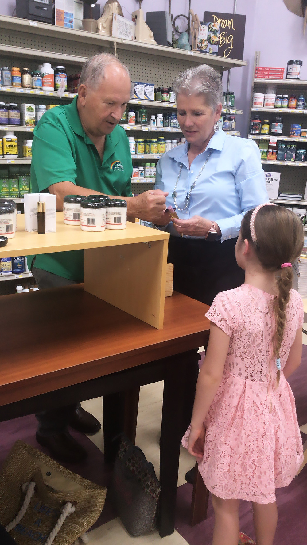 Debbie and Leon, Owners of Both Debbie's Health Foods In Orang City Florida And Port Orange Florida. Trying Out Strawberry Lane Perfume.