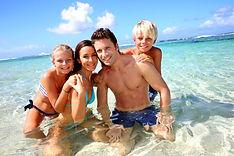 169746-700x466-family-beach.jpg