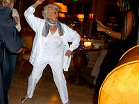 Woman dancing to Ron Levy's music.