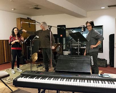 Singers recording music.