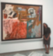 Prima poses with Basquiat painting at National Portrait Gallery in Washington, D.C.