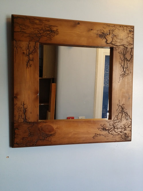 Mirror wall mounted with fractal burning design frame