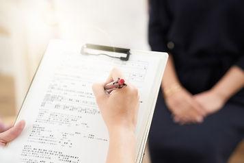 nurse writing in medical record