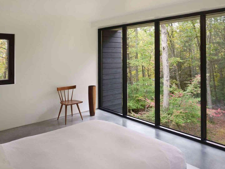 White-platform-bed-with-large-black-wind