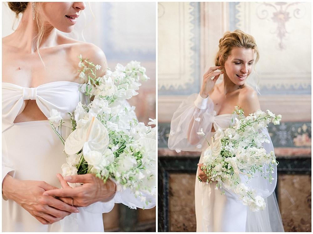 Portrait de la mariée lors de son mariage au Château de Sénéguier, zoom sur son bouquet destructuré, sa robe à manches bouffantes.
