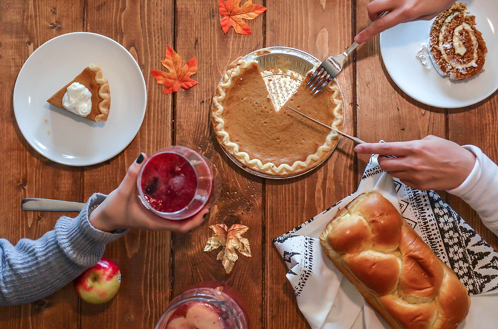 Thanksgiving table with pie and drinks