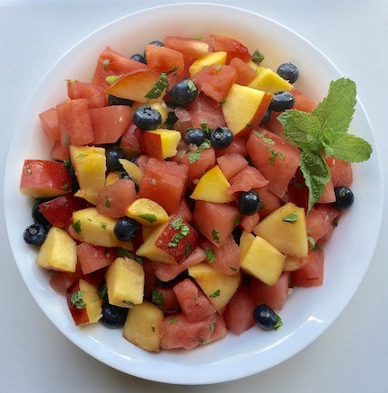 summer fruit salad with watermelon, nectarines, blueberries, mint and lime