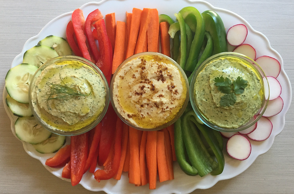 original hummus, lemon dill hummus, cilantro lime hummus and veggies