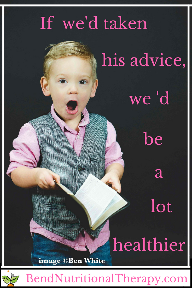surprised little boy with book
