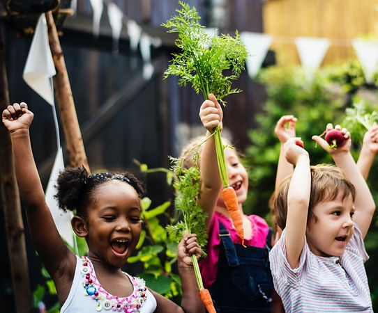 kids-in-a-vegetable-garden-with-carrot-p