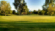 Uphill par four at Minnewaska Golf Club with Lake Minnewaska in the background.