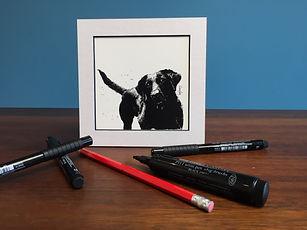 Black ink dot mounted  print of a black Labrador 15 x 15 cm