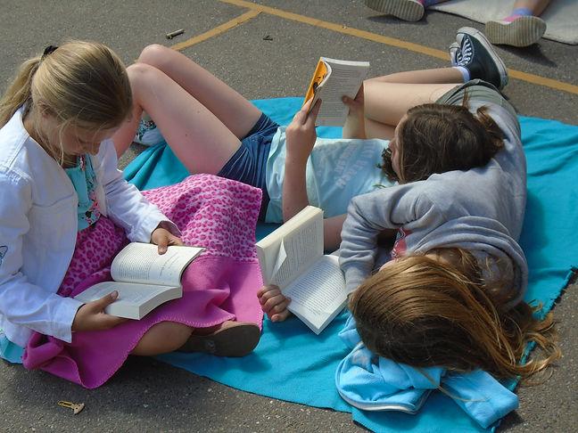 3 girls reading.JPG