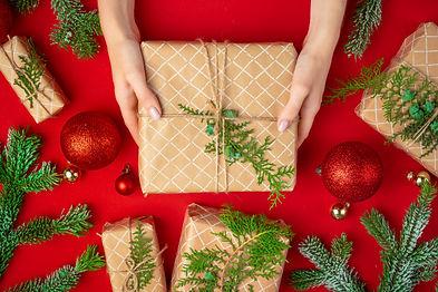 hands-woman-holding-christmas-gift-box-r