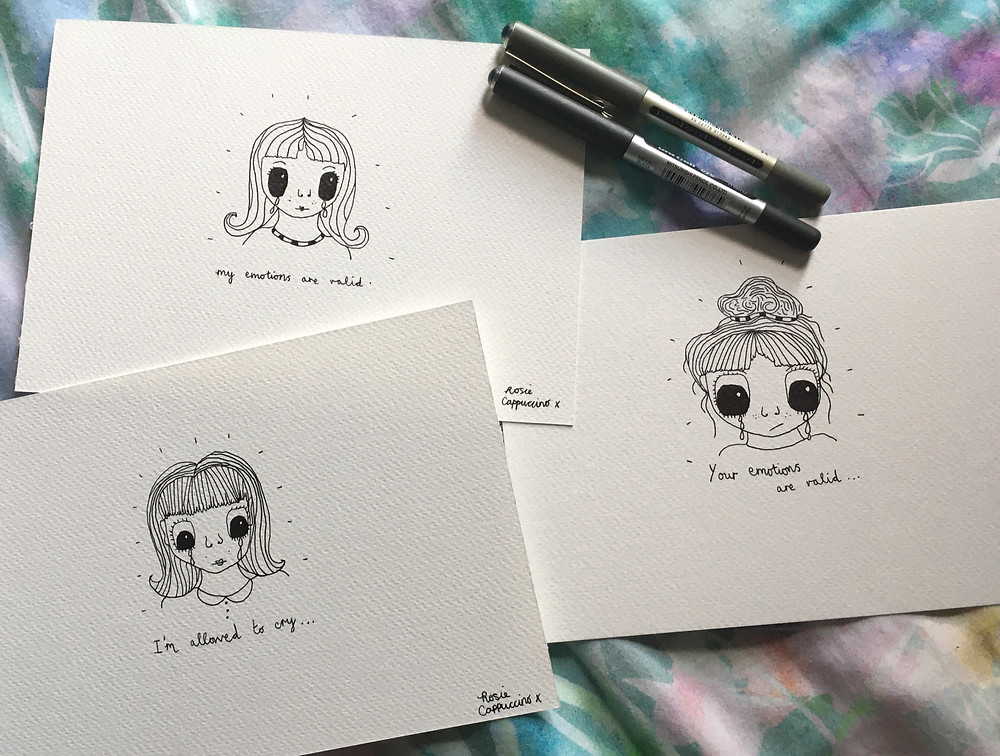 Photo shows three pen and ink drawings of girls crying.