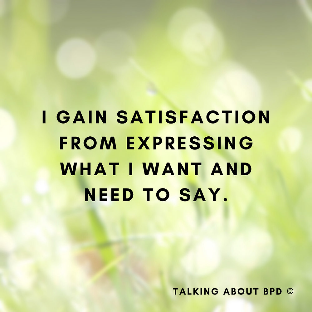 The text reads 'I gain satisfaction from expressing what I want and need to say'. The background is wet green grass.