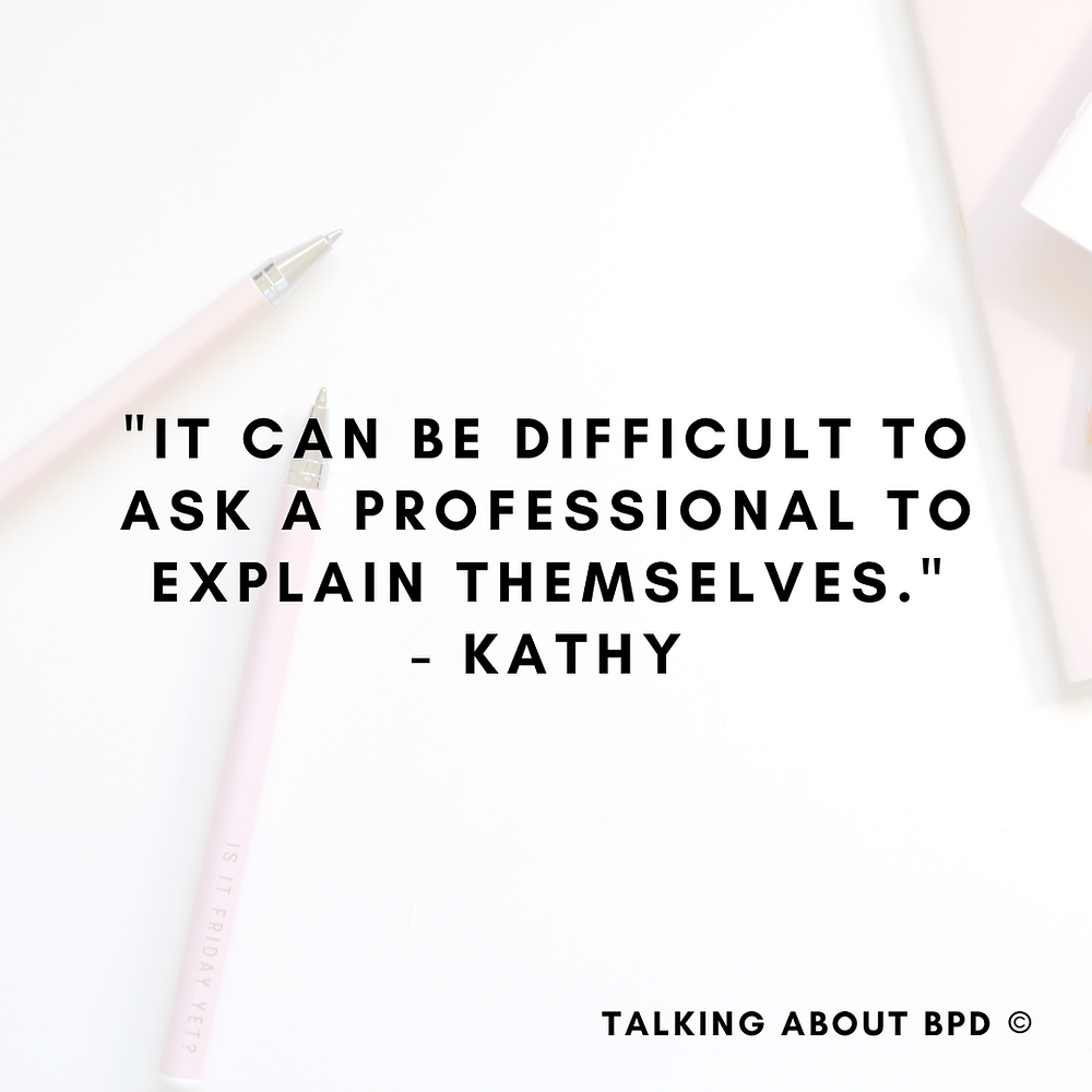 background is a white desk with pink pens and notebook. The text reads: 'It can be difficult to ask a professional to explain themselves' - Kathy