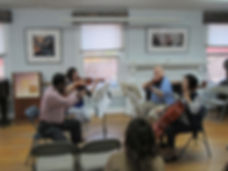 An amateur chamber music group being coached at the workshop.  An amateur string quartet being coached at the workshop.