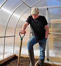 Bob in greenhouse looking down.jpg