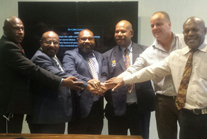 Minister for Agriculture and Livestock and Maprik MP John Simon (second left), other heads and stakeholders during signing of an agreement to revive PNGs livestock sector.