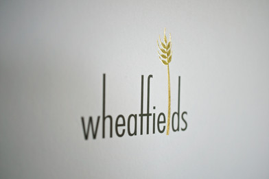 Wheatfields restaurant branding and print production.