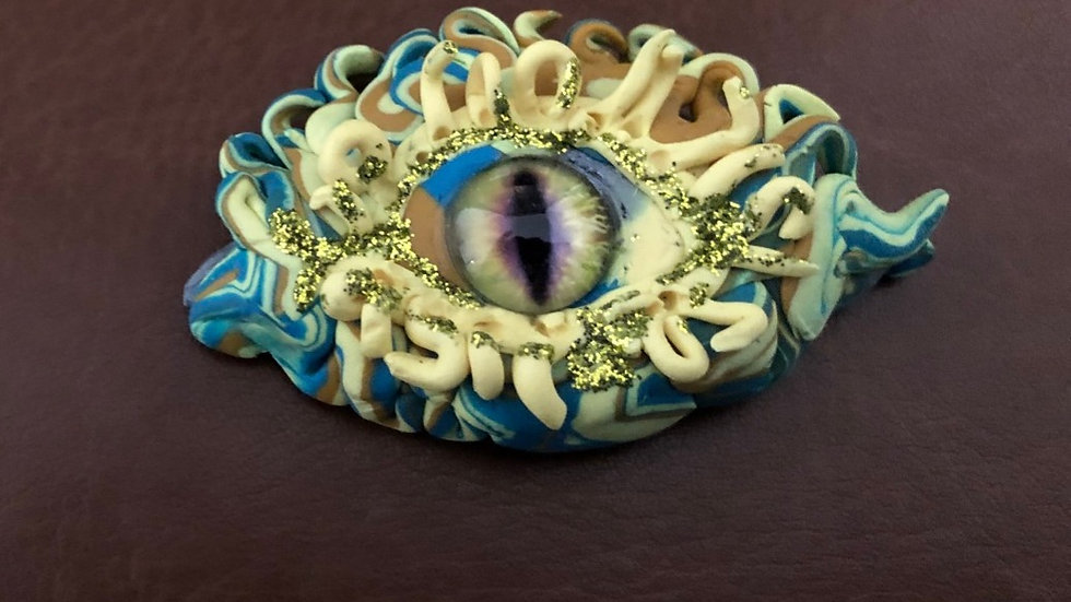 Blue and Yellow Dragon's Eye with Glass Center