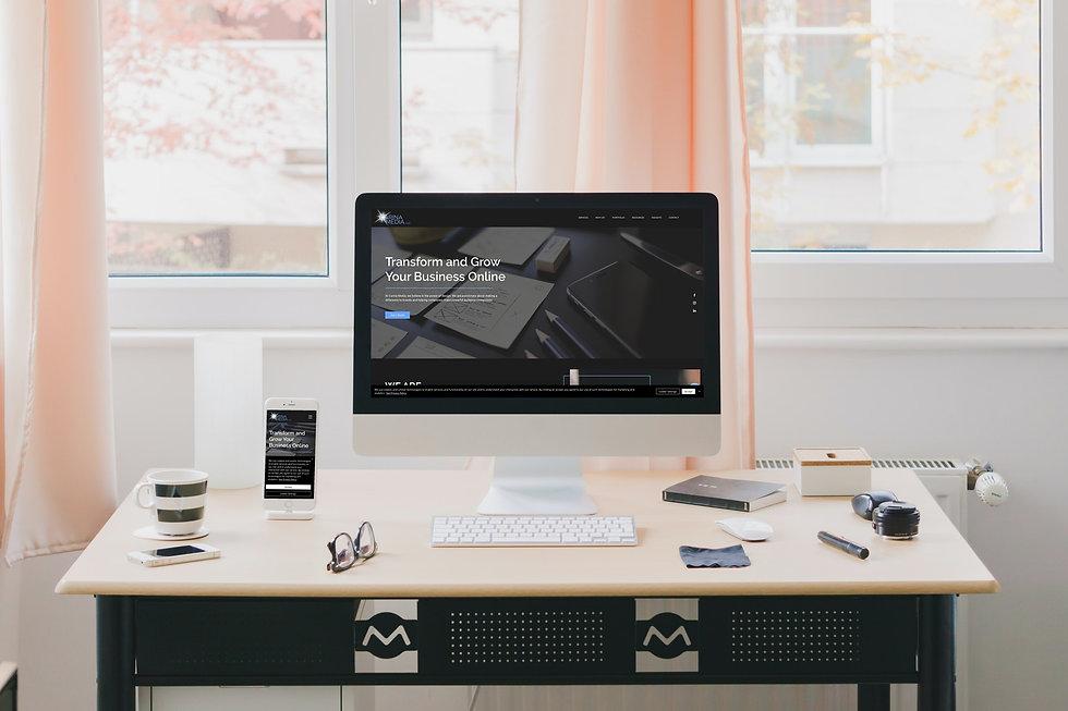 Desk with large desktop computer