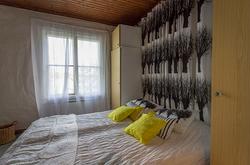 Merenrantahuvila makuuhuone