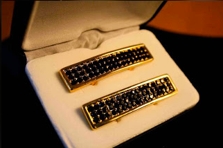 Sneakbars gold tone with black rhinestones