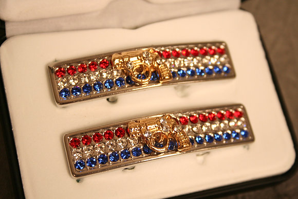 silver tone w/gold tone revolver red, white, blue
