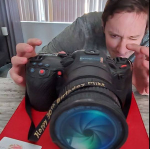 Here's Mike posing with his Camera Birthday Cake!