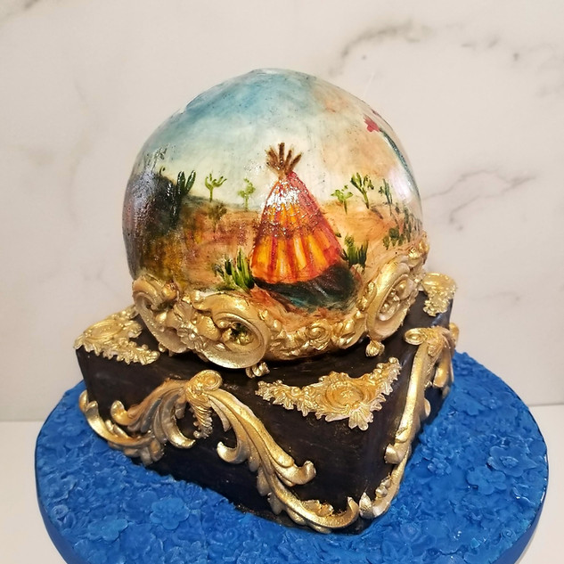 Crystal Ball cake with hand painted cocoa butter desert theme