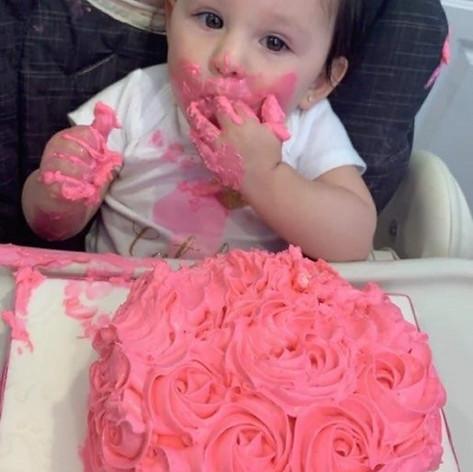 Catalya Enjoying Her First Birthday Cake