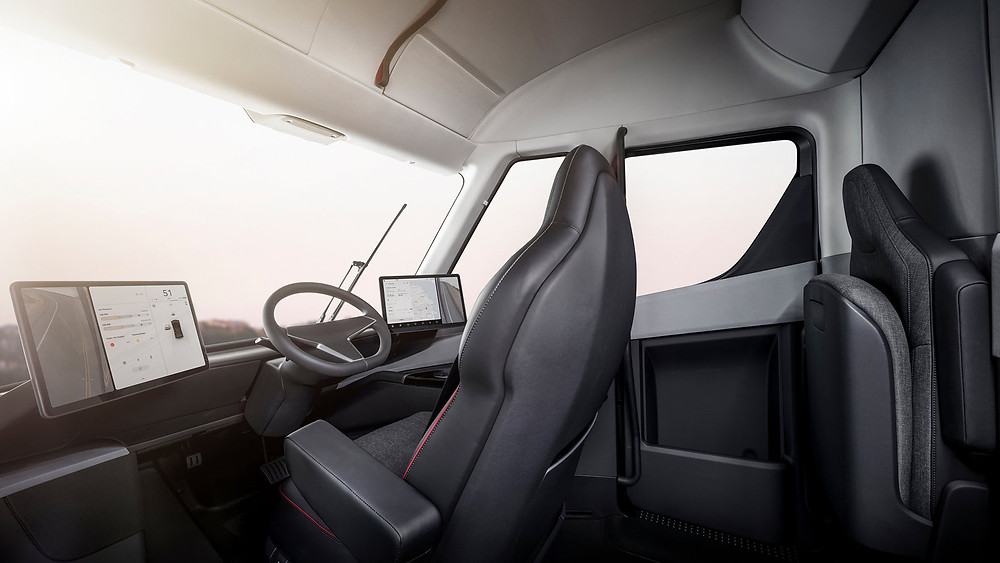 The driver's seat of the Tesla Semi is positioned in the center of the cab — which also provides standing room.