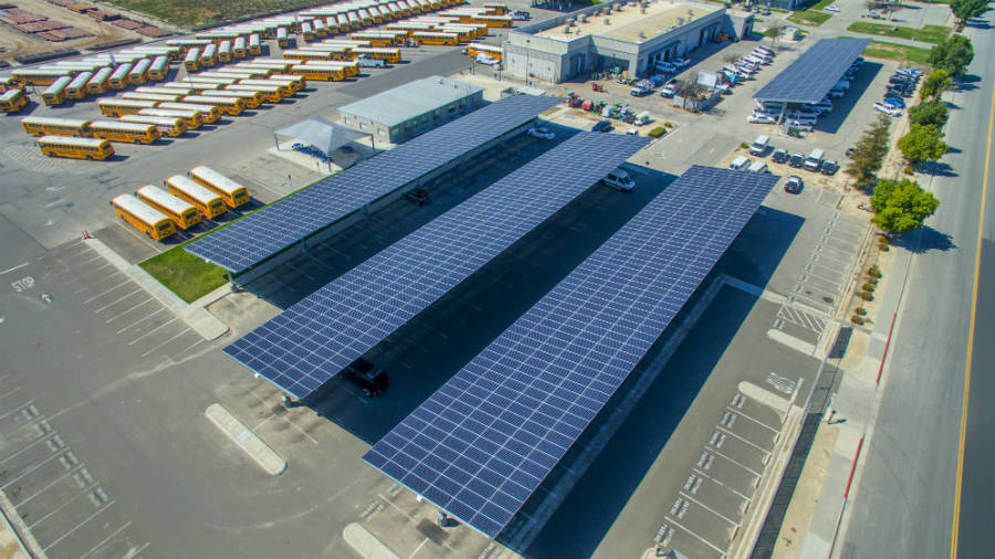 Schools have added solar panels on rooftops, above parking lots and in open fields to help reduce their electricity costs. Credit: Sage Renewables​