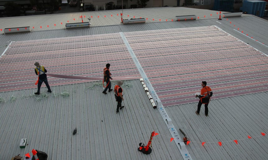 Organic printed solar cells on sub-millimetre thin plastic sheets being installed at the pilot project. Photograph: Newcastle University