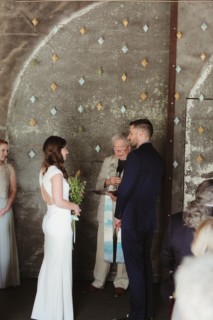 Exchanging Vows in Front of the Antique Steel Wall