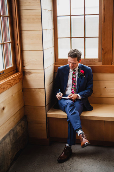 A groom reads his vows