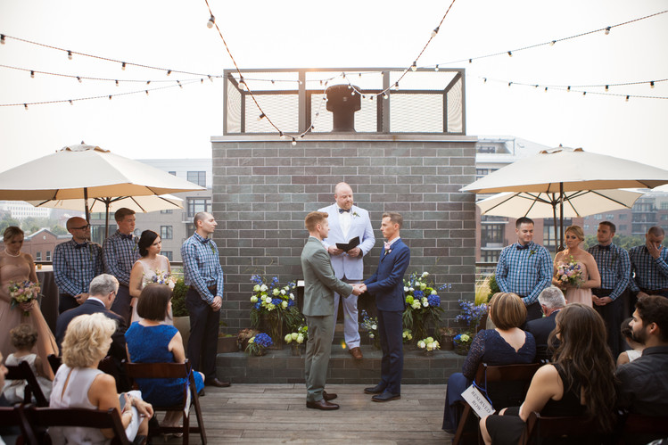 Rooftop Ceremony in front of the Fireplace