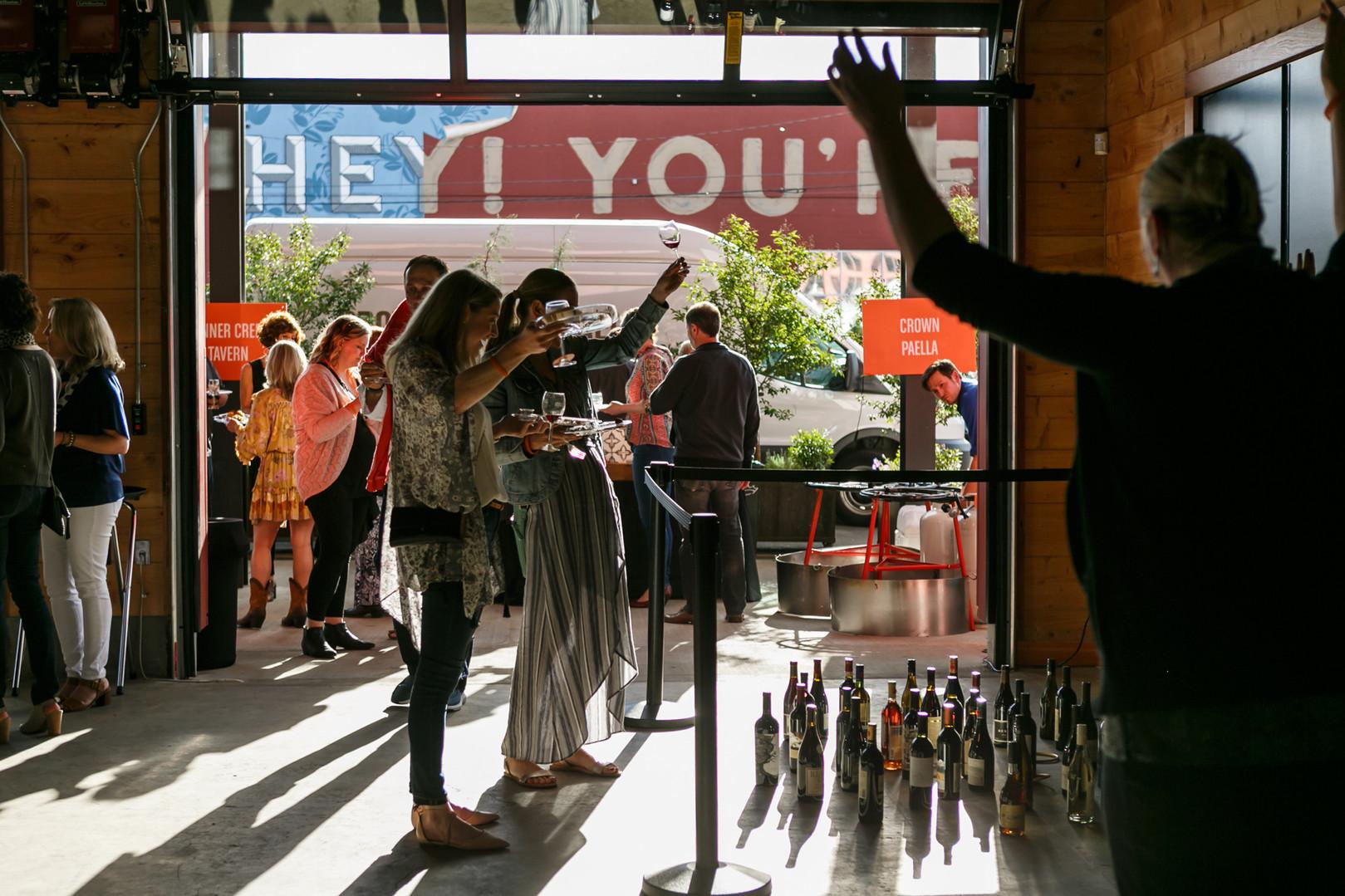 Wine Toss Fundraiser game near the garage doors in Redd Main Hall
