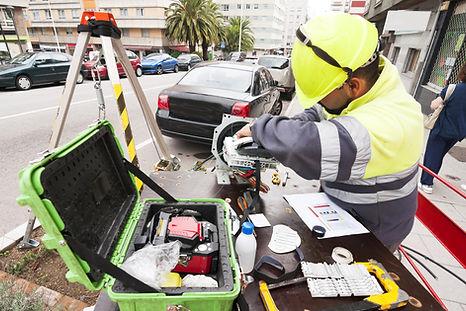 electrician worker install optical fiber system in city street_Description_ electrician w