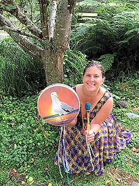 customer with her 12-inch shaman drum painted