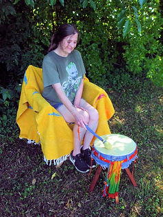 angie playing jeans drum 600w.jpg