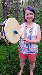a customer proudly holds her drum circle Drum from Thunder Valley Drums
