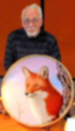 accomplished artist Glenn W. Lewis with one his painted shaman drums