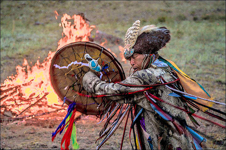 Siberian shaman dancing with drum