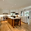 Thumbnail: Painted Perimeter Cabinets with Stained Grade Island